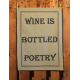 Küchentuch: Wine is bottled poetry